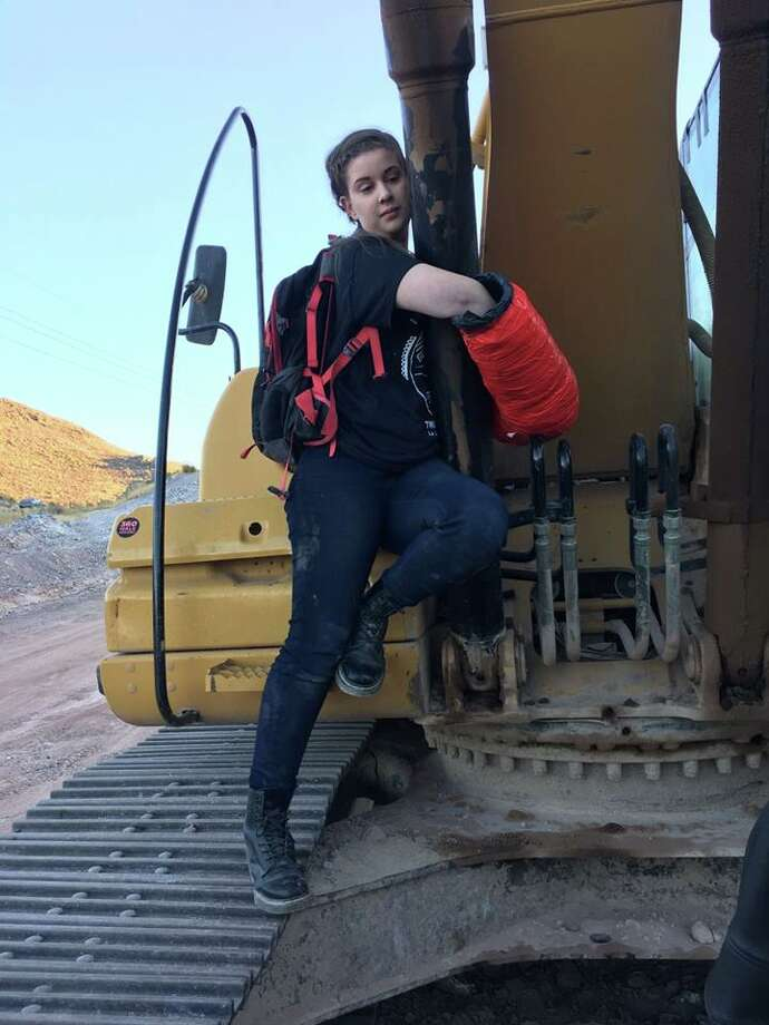 Anna Joy Kruger wrapped her arms around an excavator and then affixed them together with a cast. She could face a charge of criminal mischief, a felony.  Photo: Courtesy Of The Presidio County Sheriff's Office