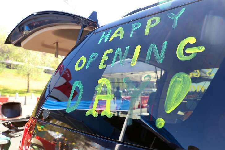 """Happy Opening Day"" greets fans on a tailgater's vehicle in parking lot before Oakland Athletics' home opener at the Oakland Coliseum in Oakland, Calif., on Monday, April 3, 2017."