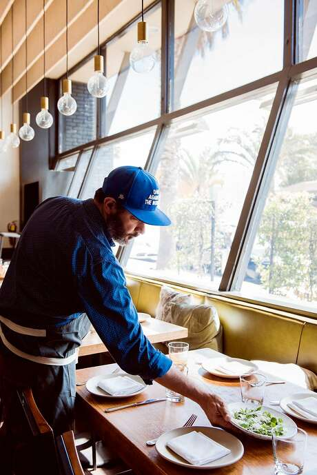 Chef Jeremy Fox sets down a plate at Rustic Canyon Wine Bar and Seasonal Kitchen in Santa Monica. Photo: Julia Stotz, Special To The Chronicle