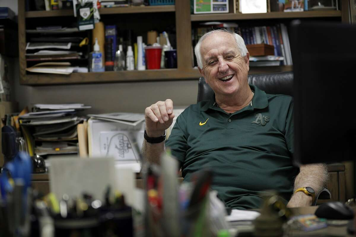 Steve Vucinich, A's equipment manager, chuckles at a joke in his office in the clubhouse while prepping for the start of his 50th season with the team in 2017. Vucinich has announced that this season - his 54th with the A's - will be his final full one; he will retire after spring training next year.
