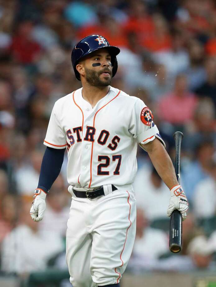 Houston Astros second baseman Jose Altuve (27) reacts after striking out in the first inning of the Houston Astros at Minute Maid Park, Friday, March 31, 2017, in Houston. Photo: Karen Warren, Houston Chronicle / 2017 Houston Chronicle
