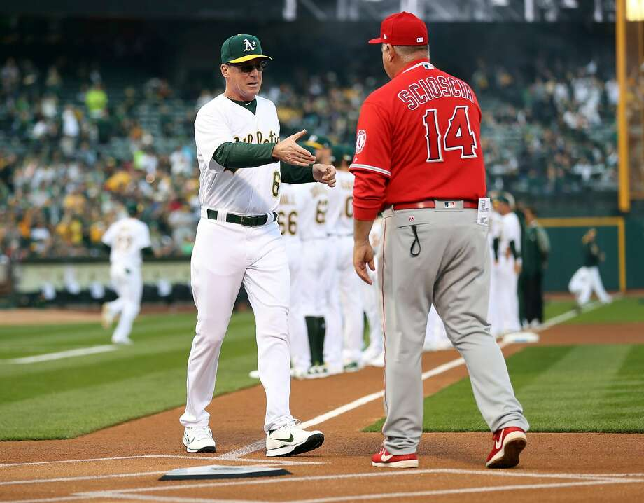Oakland Athletics' manager Bob Melvin shakes hands with Anaheim Angels' manager Mike Scioscia during A's home opener at the Oakland Coliseum in Oakland, Calif., on Monday, April 3, 2017. Photo: Scott Strazzante / The Chronicle