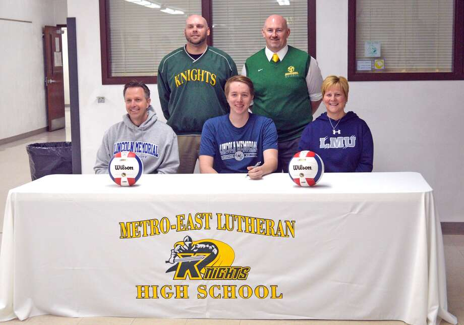 Metro-East Lutheran senior AJ Risavy signed with Lincoln Memorial University for volleyball. In the front row, left to right, are father Art Risavy, AJ Risavy and mother Rhonda Risavy. In the back row are MELHS athletic director Rob Stock, left, and MELHS boys' volleyball coach Jason Batty.