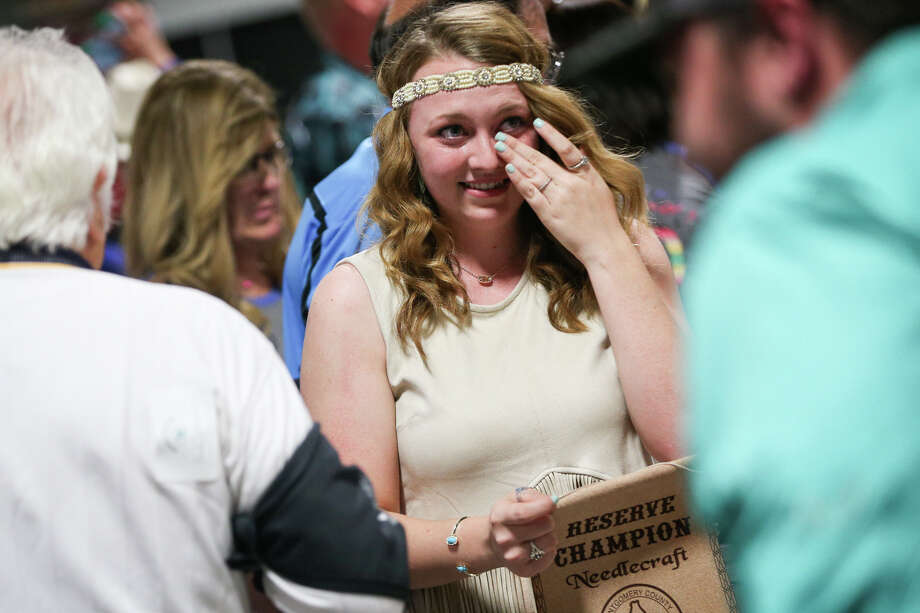 Montgomery Dobbin 4-H's Carli Seiter wipes tears away after her reserve champion Needlecraft entry sold for $20,000 during the Non-Livestock Auction on Monday, April 3, 2017, at the Montgomery County Fairgrounds. Photo: Michael Minasi/Houston Chronicle