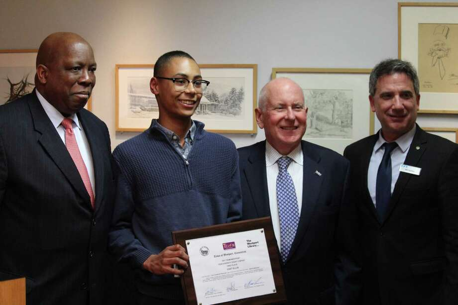 From left to right: TEAM Westport Chair Harold Bailey, Jr., essay competition winner Chet Ellis, First Selectman Jim Marpe and Westport Library Executive Director Bill Harmer. Photo: Chris Marquette / Hearst Connecticut Media / Westport News