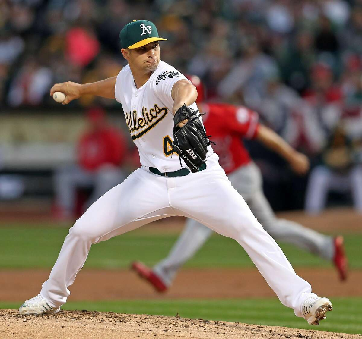 Oakland Athletics' Kendall Graveman delivers in 3rd inning against Anaheim Angels during A's home opener at the Oakland Coliseum in Oakland, Calif., on Monday, April 3, 2017.