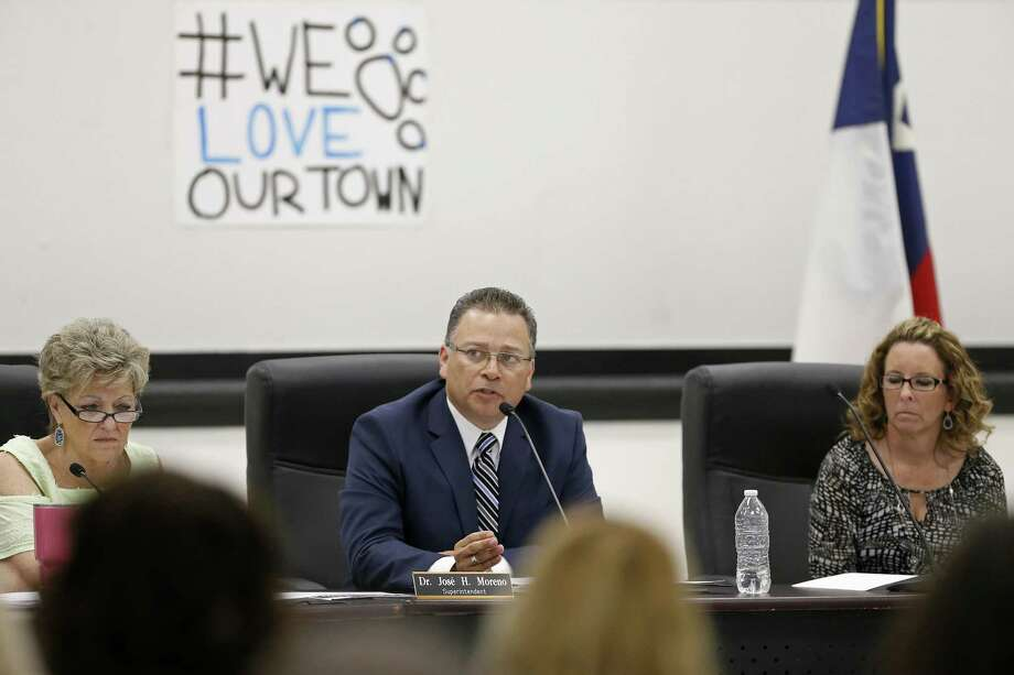 La Vernia Independent School District Superintendent Jose H. Moreno (center) speaks during a board of trustees meeting held Monday April 3, 2017 at La Vernia High School in La Vernia, TX., as board president Janice Gimbel (left) and board secretary Susan Reinhard listen. Photo: Edward A. Ornelas, Staff / San Antonio Express-News / © 2017 San Antonio Express-News