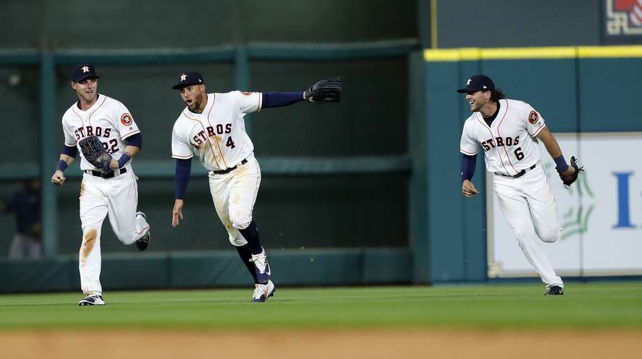 Houston Astros George Springer (4), Josh Reddick (22) and Jake Marisnick (6)run in from the outfield after the final out in the ninth inning of the Houston Astros at Minute Maid Park, Monday, April 3, 2017, in Houston.  Astros won the game 3-0. ( Karen Warren / Houston Chronicle ) Photo: Karen Warren/Houston Chronicle