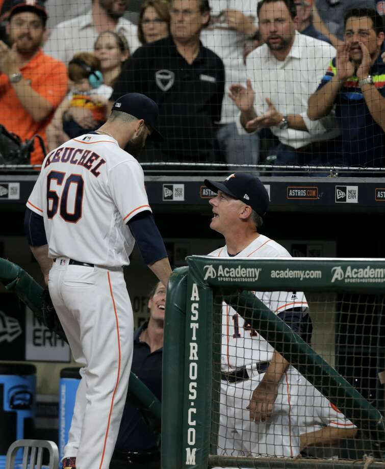 Houston Astros manager A.J. Hinch (14) congratulates Houston Astros starting pitcher Dallas Keuchel (60) at the end of the seventh inning against Seattle Mariners  at Minute Maid Park on Monday, April 3, 2017, in Houston. ( Elizabeth Conley / Houston Chronicle ) Photo: Elizabeth Conley/Houston Chronicle