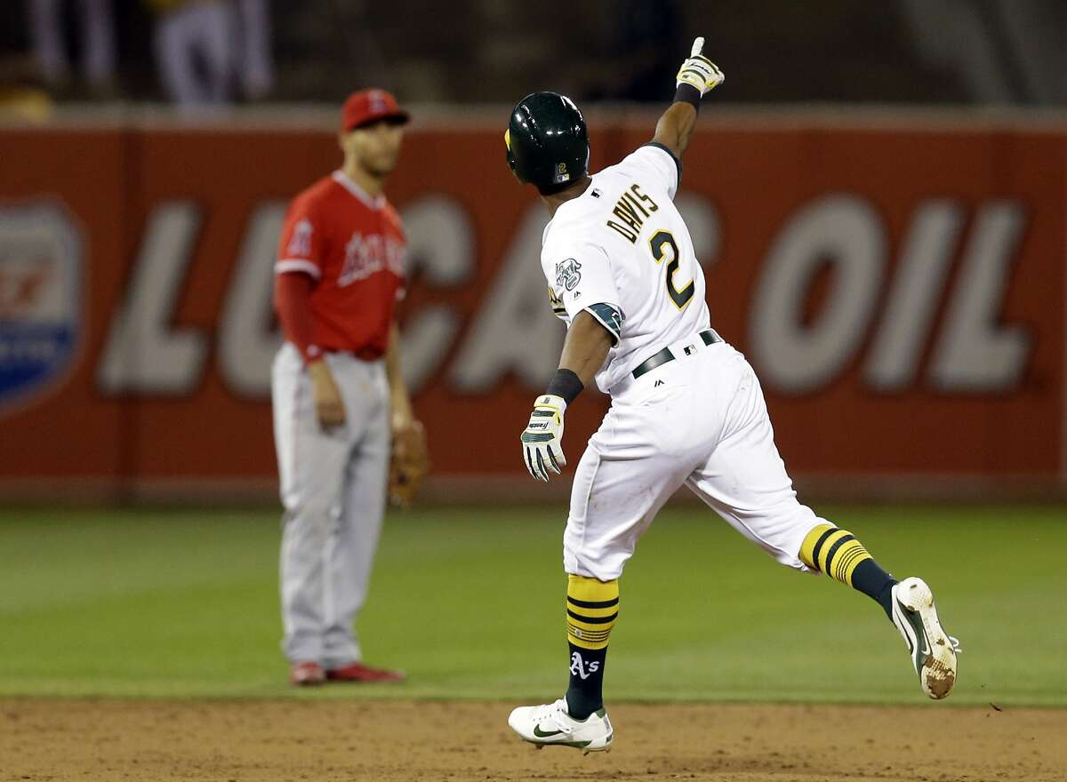 Oakland Athletics' Khris Davis (2) celebrates after hitting a home run off Los Angeles Angels' Ricky Nolasco in the sixth inning of a baseball game Monday, April 3, 2017, in Oakland, Calif. (AP Photo/Ben Margot)