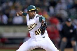 Oakland Athletics' closer Santiago Casilla pitches while earning the save in 4-2 win over Anaheim Angels in A's home opener at the Oakland Coliseum in Oakland, Calif., on Monday, April 3, 2017.