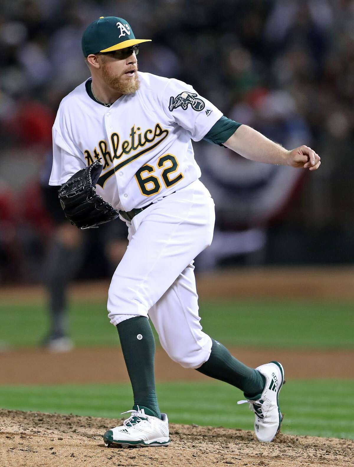 Oakland Athletics' Sean Doolittle pitches in 8th inning of 4-2 win over Anaheim Angels during A's home opener at the Oakland Coliseum in Oakland, Calif., on Monday, April 3, 2017.