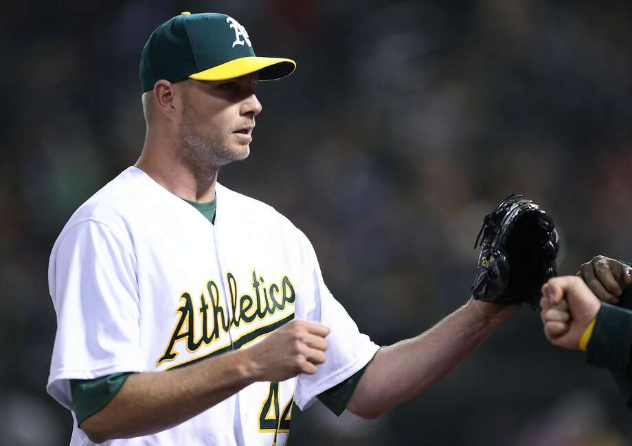 Oakland Athletics' Ryan Madson returns to dugout after getting third put of 8th inning during 4-2 win over Anaheim Angels during A's home opener at the Oakland Coliseum in Oakland, Calif., on Monday, April 3, 2017. Photo: Scott Strazzante, The Chronicle