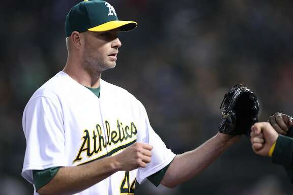 Oakland Athletics' Ryan Madson returns to dugout after getting third put of 8th inning during 4-2 win over Anaheim Angels during A's home opener at the Oakland Coliseum in Oakland, Calif., on Monday, April 3, 2017.