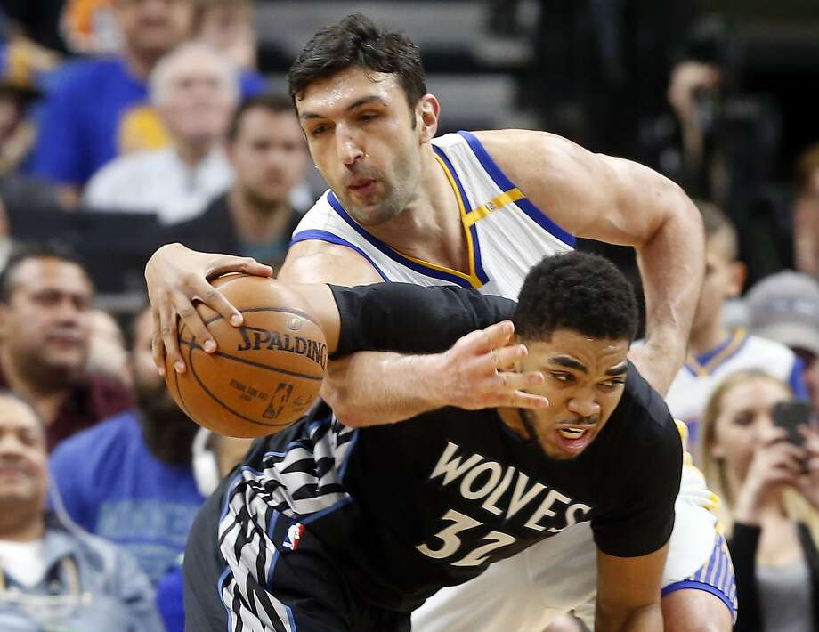 Golden State Warriors' Zaza Pachulia, top, slows down Minnesota Timberwolves' Karl-Anthony Towns during the second half of an NBA basketball game Friday, March 10, 2017, in Minneapolis. (AP Photo/Jim Mone) Photo: Jim Mone, Associated Press