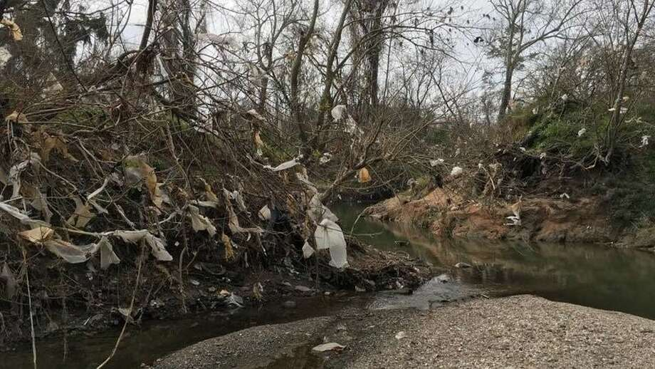 Plastic bags along Little White Oak Bayou in Woodland Park. Photo: Alan Krathaus