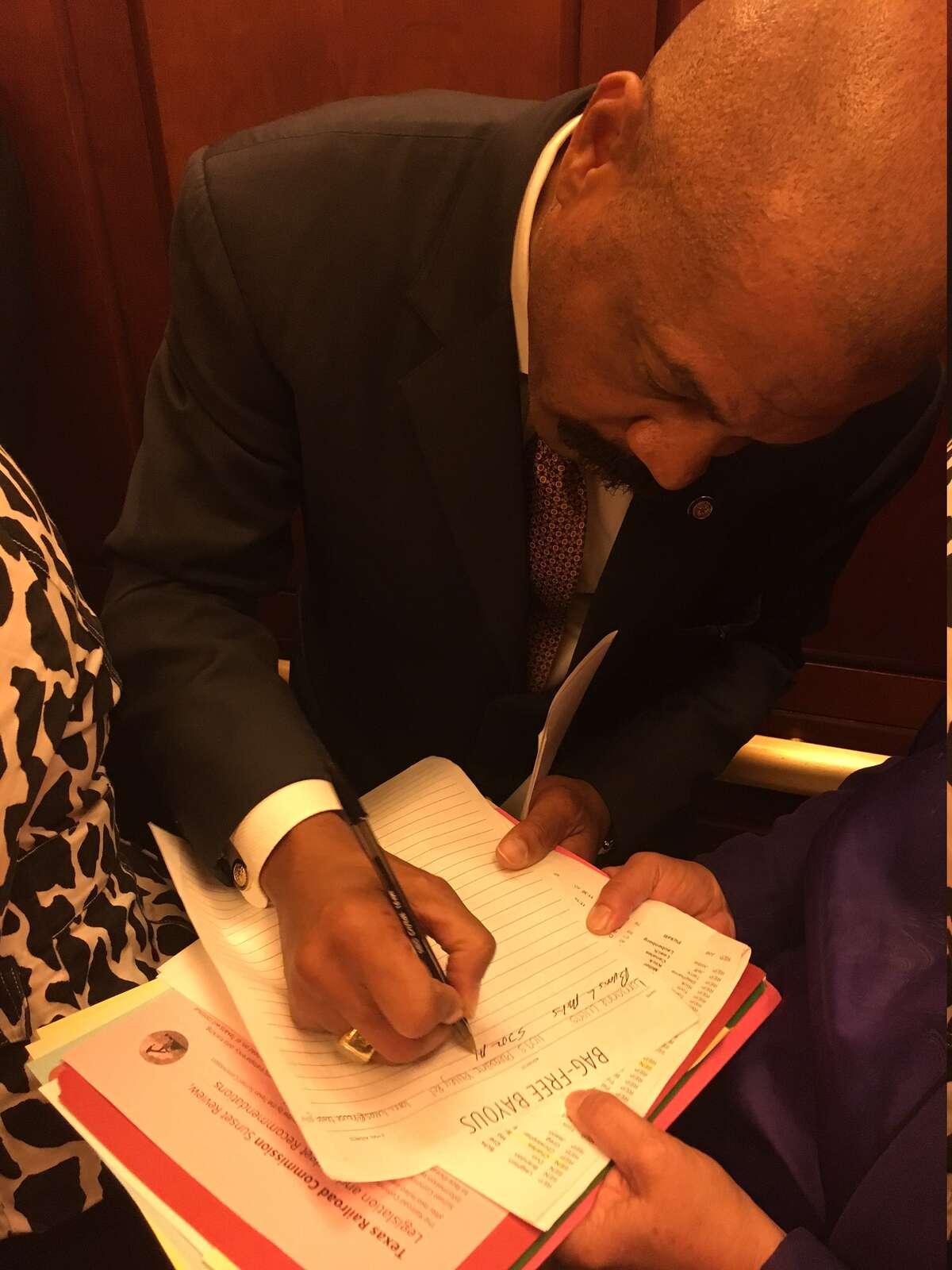 Texas state senator Borris Miles (D-Houston) signs the Bag Free Bayous petition.