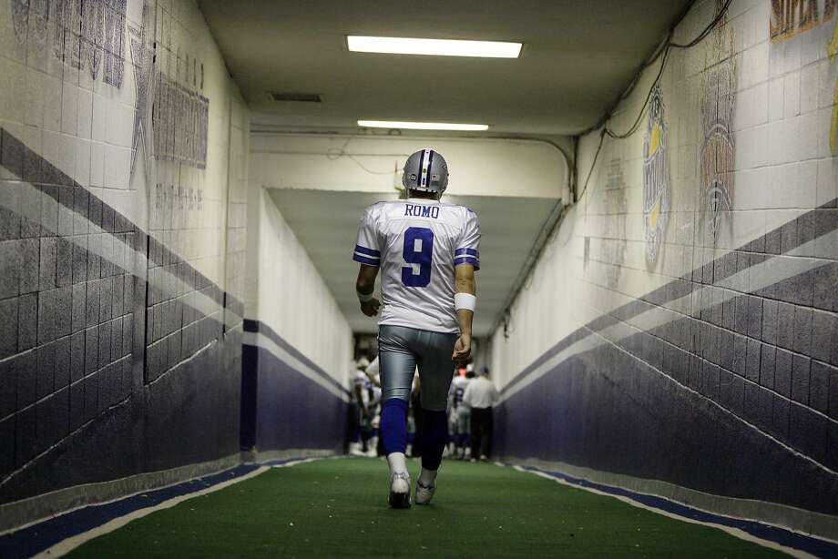 FILE - In this Dec. 20, 2008, file photo, Dallas Cowboys quarterback Tony Romo walks down the tunnel to the playing field at Texas Stadium before an NFL football game, in Irving, Texas. A person with knowledge of the decision says Romo is retiring rather than trying to chase a Super Bowl with another team after losing his starting job with the Cowboys. The all-time passing leader for the storied franchise is headed to the broadcast booth after considering those offers. The person spoke to The Associated Press on condition of anonymity Tuesday, April 4, 2017, because Romo's decision hasn't been announced.  (AP Photo/File) Photo: Anonymous, Associated Press