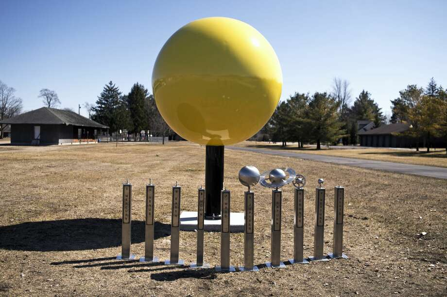 A 7.5-foot sun sculpture installed at the physical start of the solar system project, which is on the Rail-Trail at Third Street in Coleman along with the other nine other unfinished pieces that will be spaced out along the Rail-Trail. Photo: Erin Kirkland/Midland Daily News