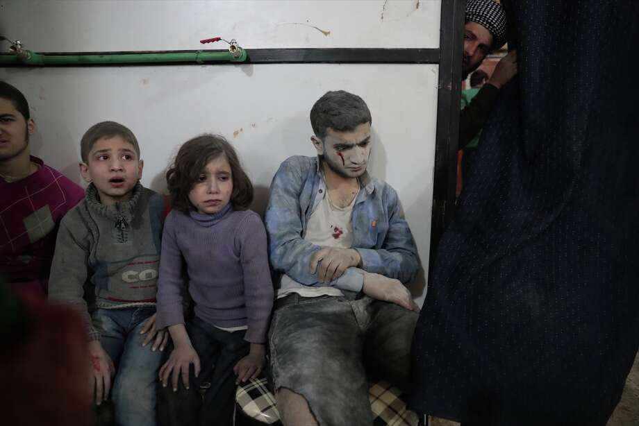 Syrian children wait to receive treatment at a makeshift clinic following reported air strikes by government forces in the rebel-held town of Douma, on the eastern outskirts of Damascus, on April 4, 2017. Photo: ABD DOUMANY/AFP/Getty Images