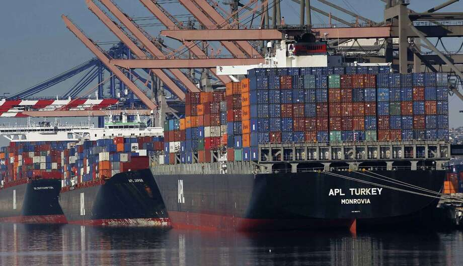 Container ships wait to be unloaded at the Port of Los Angeles. The U.S. trade deficit fell to $43.6 billion in February, 9.6 percent below January's deficit of $48.2 billion. Imports dropped 1.8 percent to $236.4 billion as the flow of Chinese goods tumbled by $8.6 billion, led by a big drop in cellphone imports. Photo: Associated Press /File Photo / Copyright 2017 The Associated Press. All rights reserved.