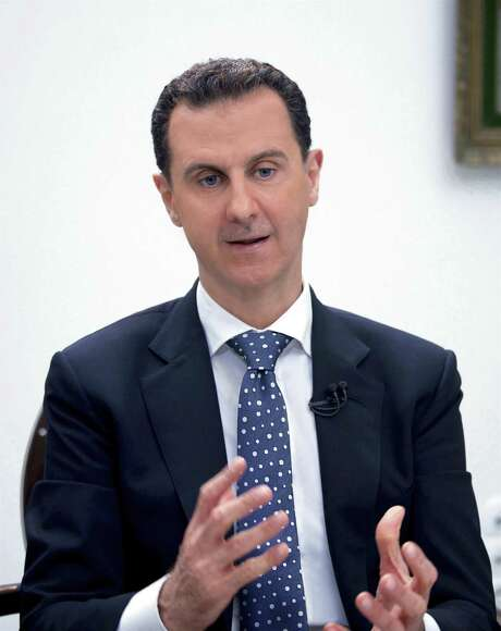 In this photo released by the Syrian official news agency SANA, Syrian President Bashar Assad, speaks during an interview with Hong-Kong based Phoenix TV in Damascus, Syria, Saturday, March 11, 2017. Assad said that his military's priority is to reach Islamic State de-facto capital Raqqa, where U.S.-backed Kurdish-led forces are advancing. (SANA via AP) Photo: Uncredited,  HOGP / Associated Press / SANA
