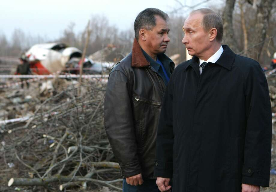 Russia's Prime Minister Vladimir Putin (R) and Emergencies Minister Sergei Shoigu visit the site of a Polish government Tupolev Tu-154 aircraft crash near Smolensk airport on April 10, 2010. A plane carrying Polish president Lech Kaczynski and much of the country's military and state elite crashed in thick fog in Russia on Saturday killing all 96 people on board in a blazing inferno. Photo: AFP/AFP/Getty Images