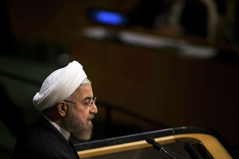 FILE Ñ President Hassan Rouhani of Iran addresses the United Nations General Assembly in Manhattan, Sept. 25, 2014. Tough talk from the Trump administration has given pause to many international companies looking to do business in Iran, where the worldÕs largest natural gas reserves has many energy companies looking to invest. (Todd Heisler/The New York Times) Photo: TODD HEISLER, STF / NYT / NYTNS