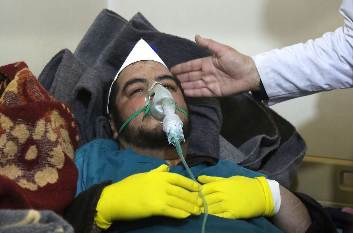 A Syrian man receives treatment at a small hospital in the town of Maaret al-Noman following a suspected toxic gas attack in Khan Sheikhun, a nearby rebel-held town in Syrias northwestern Idlib province, on April 4, 2017. Warplanes carried out a suspected toxic gas attack that killed at least 35 people including several children, a monitoring group said.