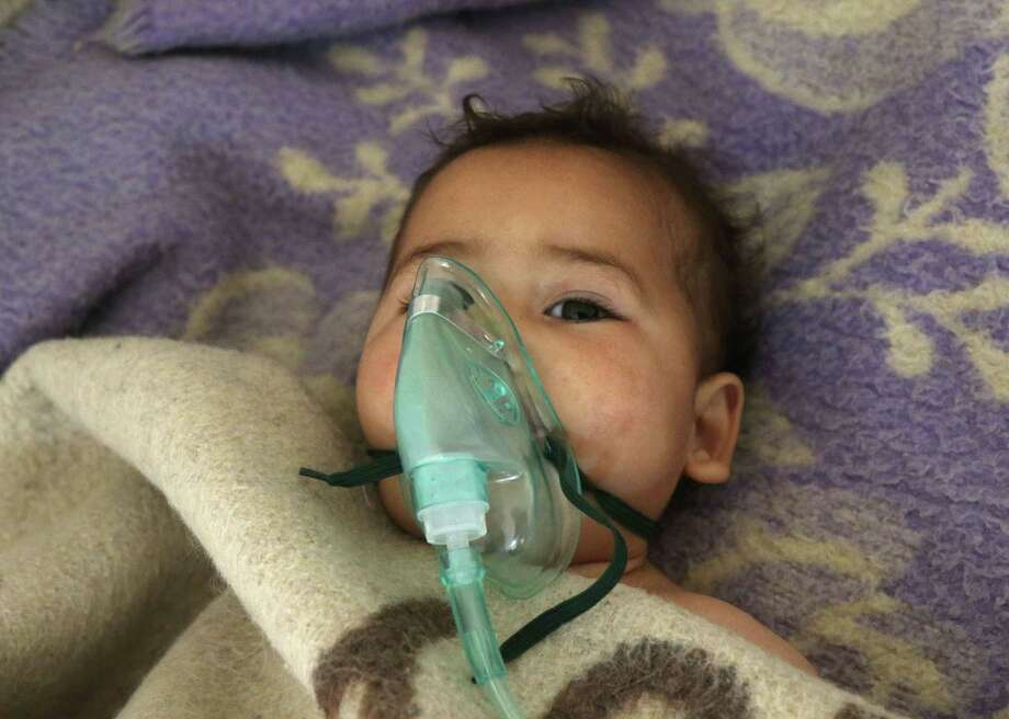 A Syrian child receives treatment at a small hospital in the town of Maaret al-Noman following a suspected toxic gas attack in Khan Sheikhun, a nearby rebel-held town in Syrias northwestern Idlib province, on April 4, 2017. Warplanes carried out a suspected toxic gas attack that killed at least 35 people including several children, a monitoring group said. The Syrian Observatory for Human Rights said those killed in the town of Khan Sheikhun, in Idlib province, had died from the effects of the gas, adding that dozens more suffered respiratory problems and other symptoms.  / AFP PHOTO / Mohamed al-Bakour / ADDING INFORMATION IN CAPTIONMOHAMED AL-BAKOUR/AFP/Getty Images Photo: MOHAMED AL-BAKOUR, Stringer / AFP/Getty Images / AFP or licensors