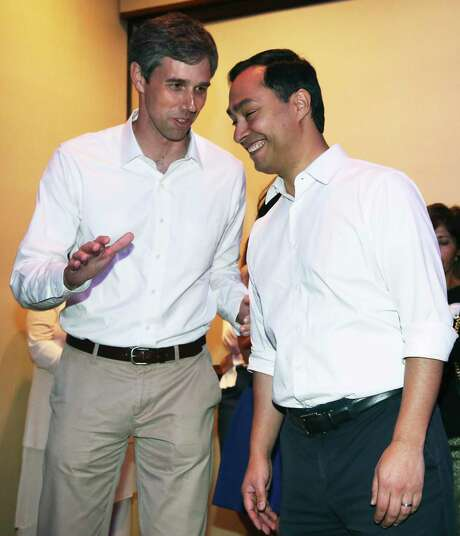 U.S. Congressmen Joaquin Castro and Beto O'Rourke exchange as they meet Saturday evening at a DNC reception at the Stephen F. Austin Hotel in Austin on April1, 2017. Photo: Tom Reel, Staff / San Antonio Express-News / 2017 SAN ANTONIO EXPRESS-NEWS