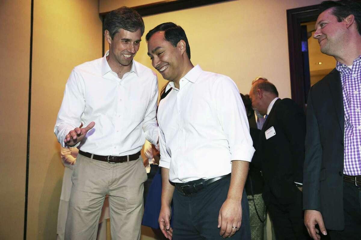 U.S. Congressmen Beto O'Rourke (left) and Joaquin Castro talk at the DNC event.