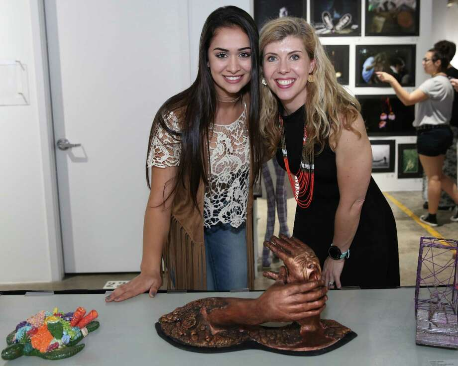"""Fatemeh Ebrahimi, a student at Taylor High School in Katy Independent School District, poses with teacher Ashley Niemi with her sculpture: """"Talk to the Hands."""" Ebrahimi won a national Gold Medal for her sculpture through Scholastic Art & Writing, as well as a regional Gold Key from Harris County Department of Education. She and Niemi are eligible to travel to New York City's Carnegie Hall to receive the national award. Photo: Harris County Department Of Education"""