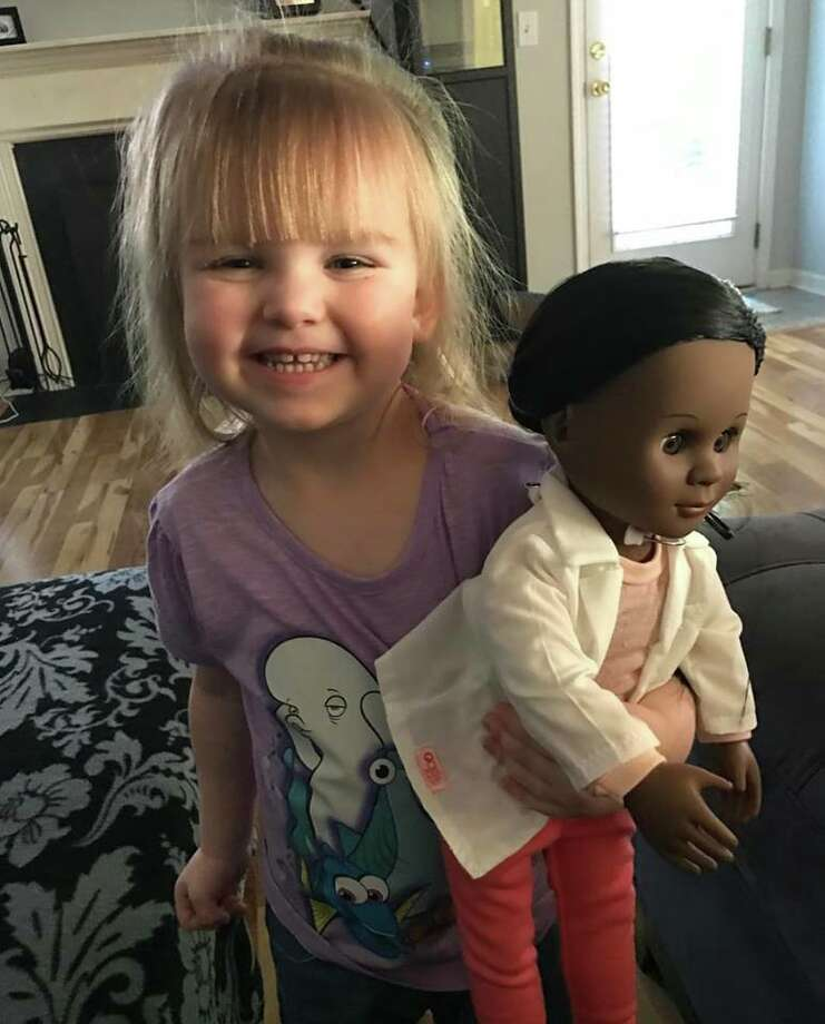 When Sophia (pictured) went shopping for a doll she selected a doll based on her profession, not her skin tone. Photo: Photo By Brandi Banner
