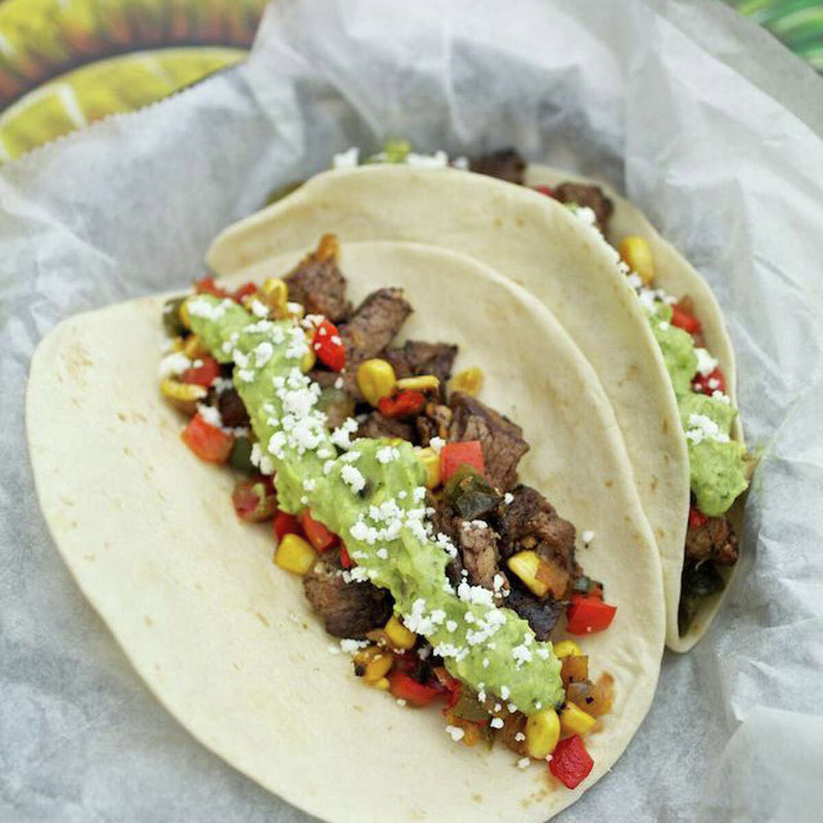 The Cowboy Taco (dry-rubbed beef tenderloin, grilled corn, caramelized onions, roasted peppers, guacamole, and queso fresco) at Tacodeli opening in Houston on April 11.