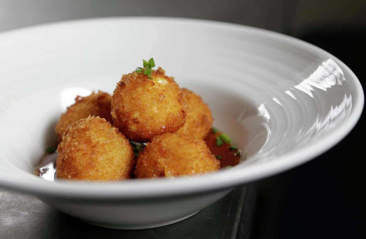 Pimento cheese fritters with pepper jelly at Field & Tides.