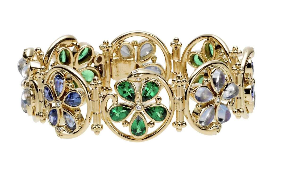 18K Flower Serpent Bracelet with royal blue moonstone, blue sapphire, tsavorite and diamond byTemple St. Clair, $23,000, at Saks Fifth Avenue and Deutsch & Deutsch