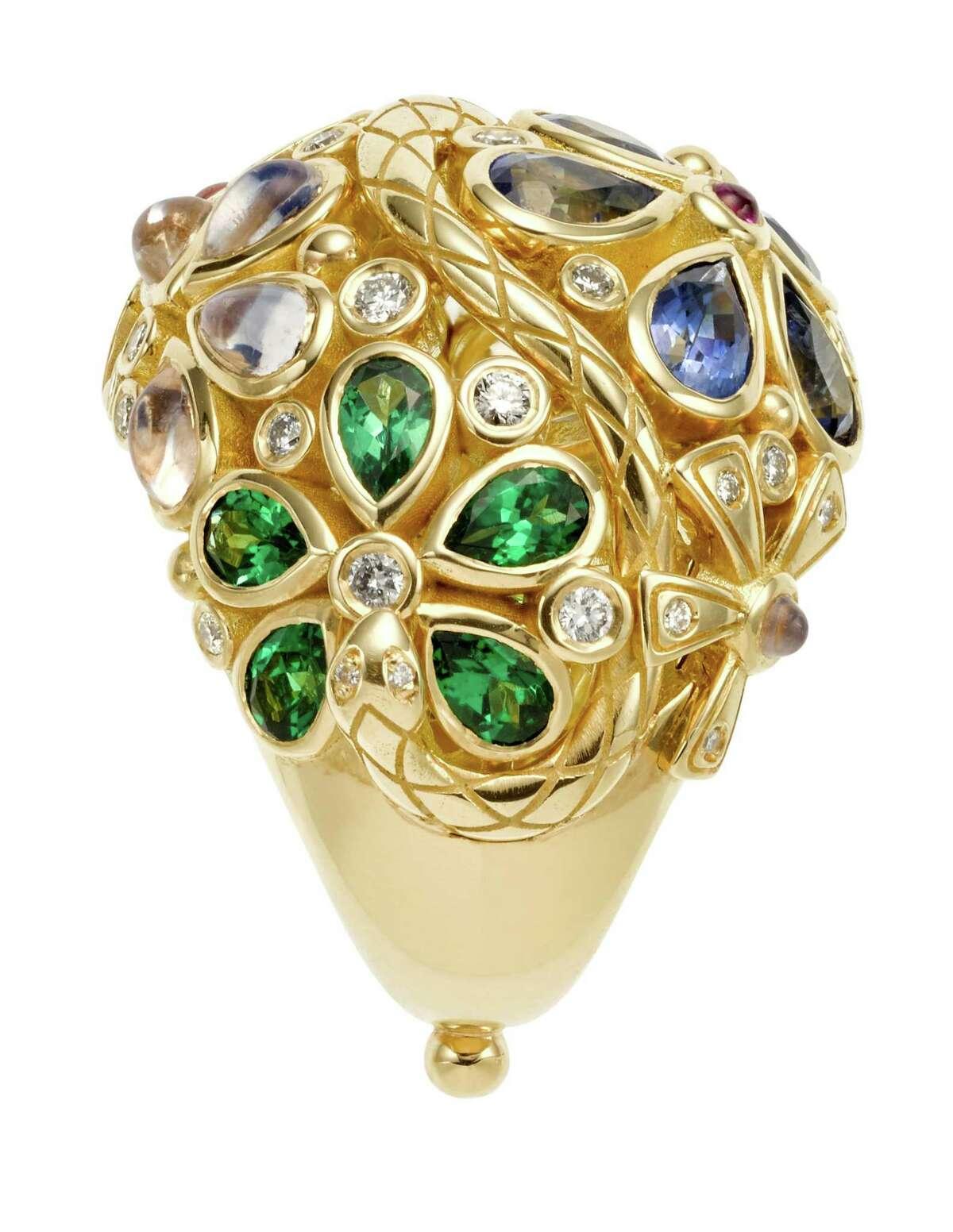 18K Flower Serpent Ring with royal blue moonstone, blue sapphire, tsavorite, pink tourmaline and diamond byTemple St. Clair, $15,000, at Saks Fifth Avenue and Deutsch & Deutsch