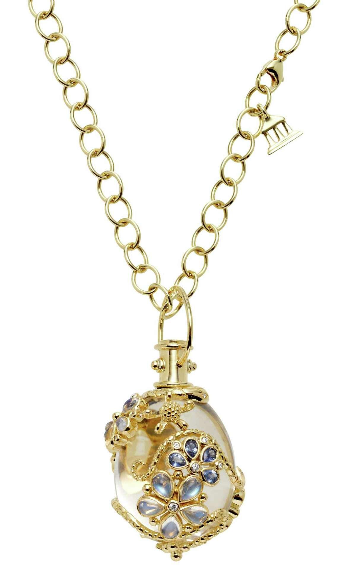 18K Flower Serpent Amulet with rock crystal, royal blue moonstone, blue sapphire, tsavorite and diamondbyTemple St. Clair, $19,500, at Saks Fifth Avenue and Deutsch & Deutsch