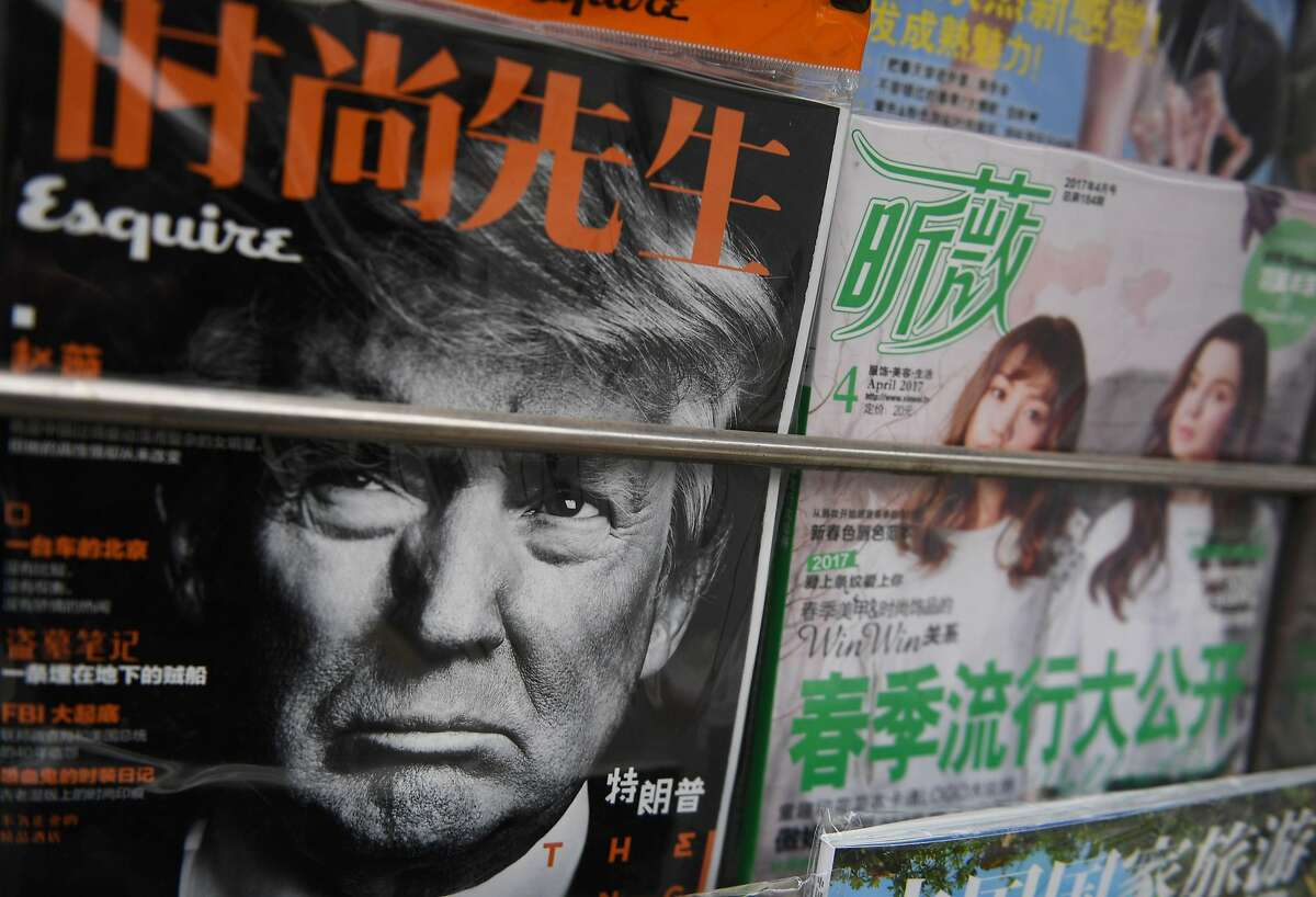 A magazine featuring a photo of President Trump is seen at a news stand in Beijing on April 4, 2017.
