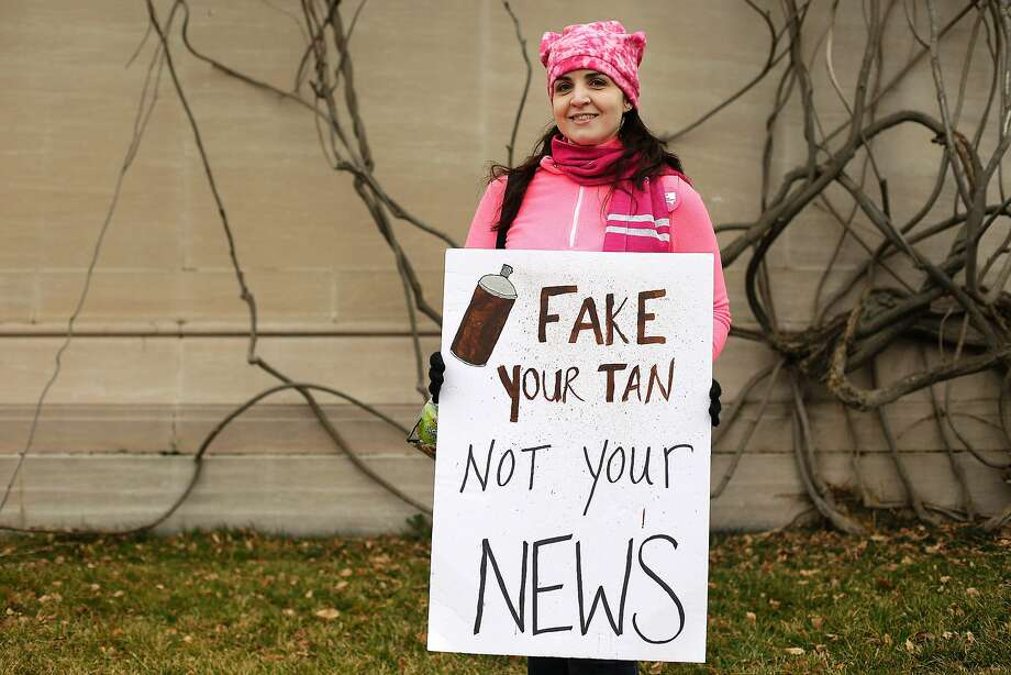 """(FILES) This file photo taken on January 21, 2017 shows protesters displaying a sign referring to """"Fake News"""" in Washington, DC, during the Womens March on January 21, 2017.  The rise of fake news has been a hot topic in Britain this year, with the lawmaker leading a probe into the phenomenon warning it was """"a threat to democracy"""".  / AFP PHOTO / Joshua LOTTJOSHUA LOTT/AFP/Getty Images Photo: JOSHUA LOTT, AFP/Getty Images"""