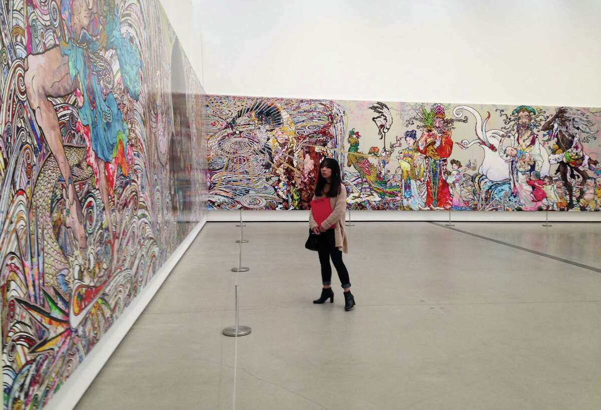 """Takashi Murakami's 82-foot long painting """"In the Land of the Dead, Sleeping on the Tail of a Rainbow,"""" consumes two walls at the Broad."""