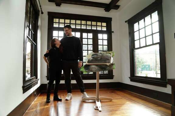 Debra Barrera and Jonathan Hopson, who run Jonathan Hopson Gallery in their home with their current exhibition from French artist, Annabelle Arlie at 904 Marshall,  Wednesday, January 25,  2017. Luxe Life story about Houston art couples who host galleries or other events in their living rooms. ( Karen Warren / Houston Chronicle )