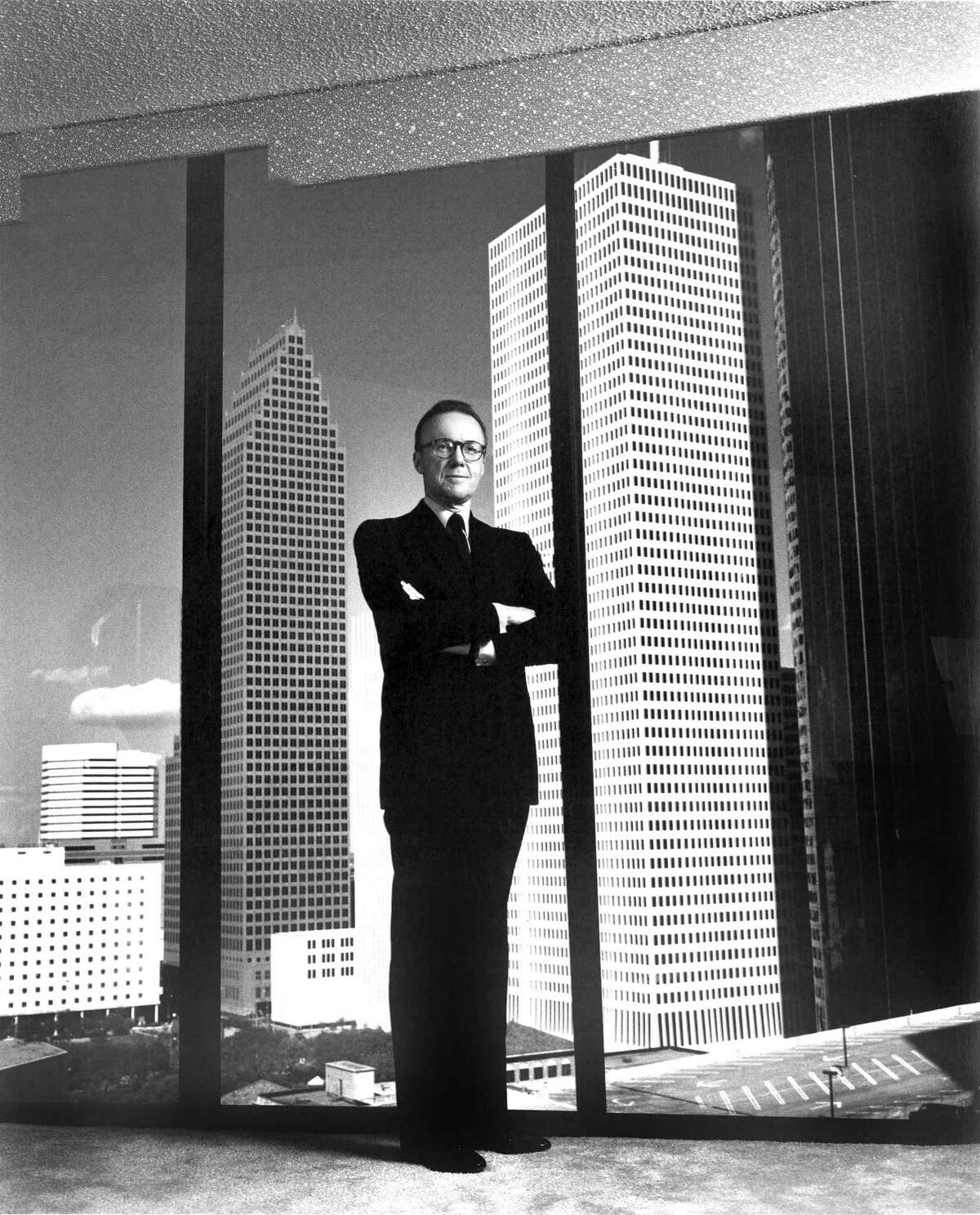 This portrait by Helmut Newton shows Hines flanked by two of his Houston landmarks, One Shell Plaza and the Bank of America Center.