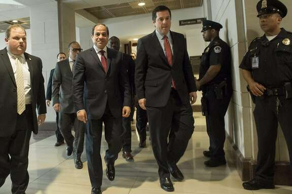 Egypt's President Abdel Fattah el-Sisi (2nd L) walks alongside US Representative Devin Nunes (2ndR), Republican of California and chairman of the House Intelligence Committee, following a meeting at the US Capitol in Washington, DC, April 4, 2017. / AFP PHOTO / SAUL LOEBSAUL LOEB/AFP/Getty Images