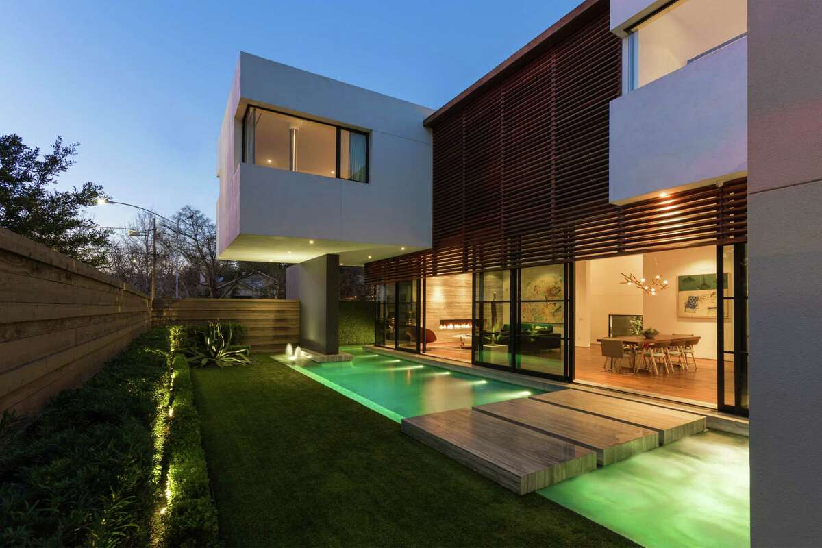 At night, the yard, pool and home of builder-developer Jonathan Farb lights up.