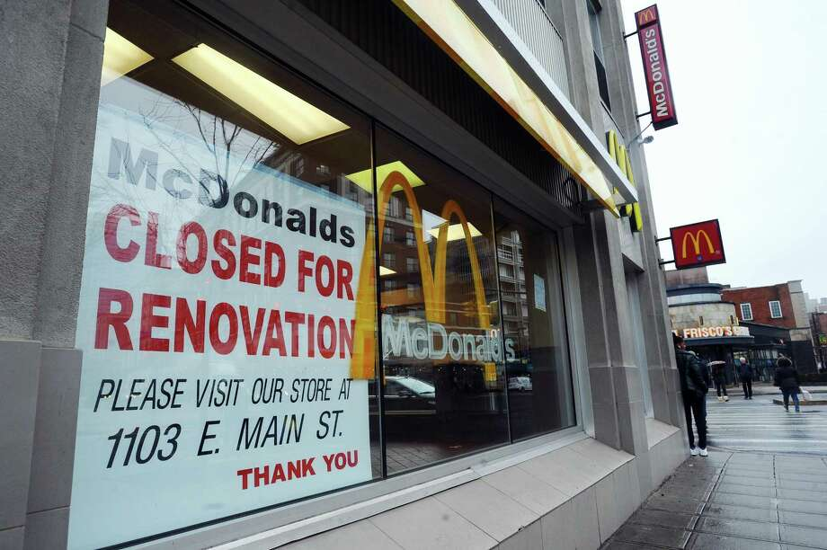"""25 Bedford St.: The downtown McDonald's closed for renovations last week, and is not expected to reopen until late June. The renovation will include a new dining room, digital kiosks and the addition of table service. The rollout of this new, more modern fast-food dining experience is beginning in the New York metro region, Florida and South Carolina, according to a McDonald's spokeswoman. A sign taped to the front window of the downtown McDonald's directs customers to dine during the renovations at the East Side location at 1103 E. Main St.  Have a question about a building or property? Email Nora Naughton with """"Point of Interest"""" in the subject line at nnaughton@stamfordadvocate.com. Photo: Michael Cummo / Hearst Connecticut Media / Stamford Advocate"""