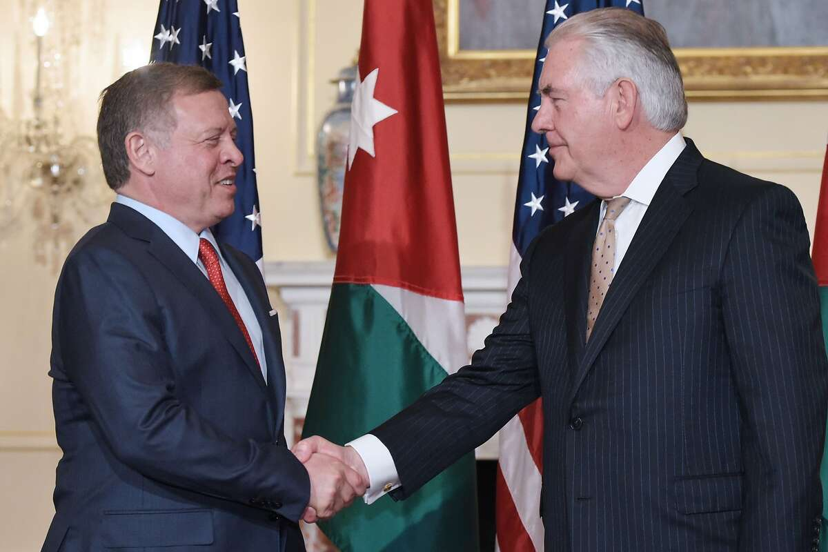 US Secretary of State Rex Tillerson (R) poses for a photo with Jordan's King Abdullah II ahead of a working lunch at the State Department in Washington, DC on April 4, 2017. / AFP PHOTO / MANDEL NGANMANDEL NGAN/AFP/Getty Images