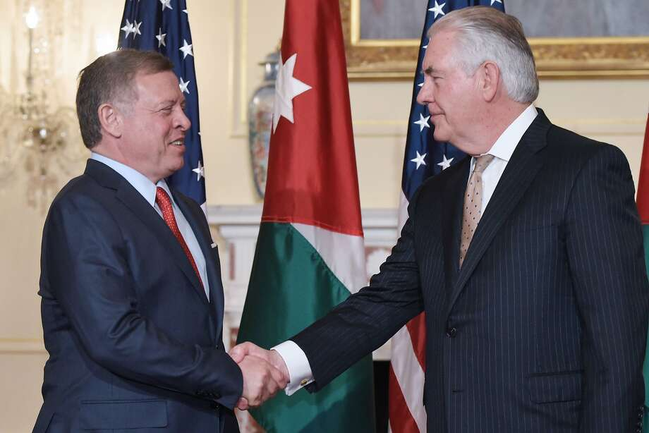 Secretary of State Rex Tillerson (right) shakes hands with Jordan's King Abdullah II. Photo: MANDEL NGAN, AFP/Getty Images