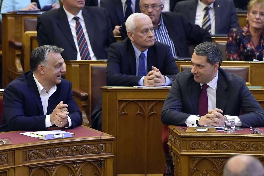 Prime Minister Viktor Orban (left) favors a law regulating foreign universities in Hungary. Photo: Zoltan Mathe, Associated Press